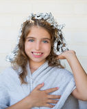 Funny kid girl smiling with his dye hair with foil. Blue eyes Royalty Free Stock Image