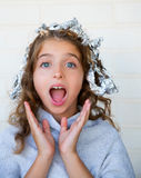 Funny kid girl surprised with his dye hair with foil. Blue eyes Royalty Free Stock Photos