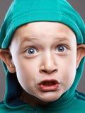 Funny kid. funny grimace emotion child stock image