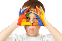 Funny kid is hamming with coloured hand. Isolated stock photography