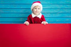 Funny child holding cardboard banner blank Stock Image