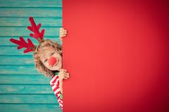 Funny kid holding cardboard banner blank Royalty Free Stock Photo