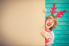 Funny kid holding cardboard banner blank Royalty Free Stock Images