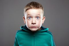 Funny kid. little boy. ugly grimace child royalty free stock photography