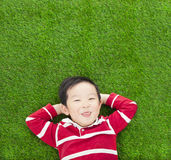A funny kid lying and holding his head Stock Photos