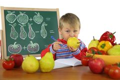 Funny kid on math lesson Royalty Free Stock Photo