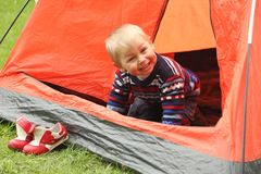 Funny kid playing in a tent on the nature Royalty Free Stock Photos