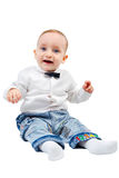 Funny kid in a shirt with a bow tie smiles Stock Photo
