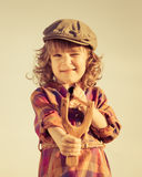 Funny kid shooting wooden slingshot Royalty Free Stock Photos