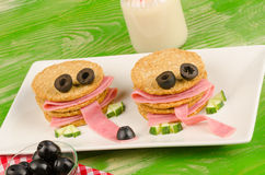Funny kid snack Stock Images