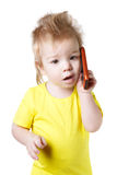 Funny kid talking on a cell phone Royalty Free Stock Image