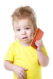 Funny kid talking on a cell phone Stock Photo