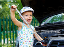 Funny kid with tape near open car bonnet Stock Photos