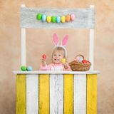 Funny kid wearing Easter bunny stock photography