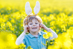 Funny kid of 3 years with Easter bunny ears, celebrating Easter Stock Photography