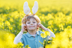 Funny kid of 3 years with Easter bunny ears, celebrating Easter Royalty Free Stock Image