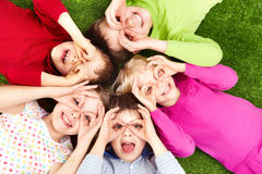 Funny kids. Image of funny kids playing on the grass stock images