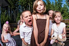 Funny Kids. A group of 6 kids making funny expressions Stock Photo