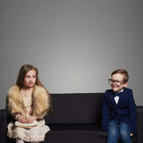 Funny kids.beautiful couple.beauty little girl in dress and boy in suit Stock Images