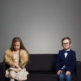 Funny kids.beautiful couple.beauty little girl in dress and boy in suit Royalty Free Stock Images