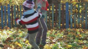 Brother and sister playing in the countryside in autumn stock video