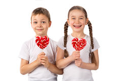 Funny kids with candy lollipops heart isolated on white. Valentine`s day. Stock Image