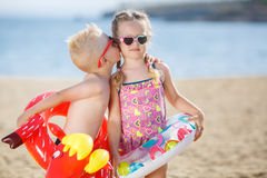 Funny kids with colorful buoys on the beach Royalty Free Stock Photos