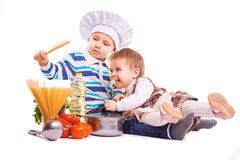 Funny kids are cooking on the kitchen. isolated Royalty Free Stock Photography