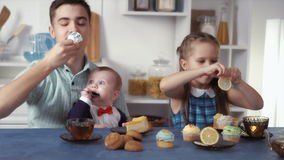 Funny kids eat sweets stock video