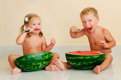 Funny kids eating watermelon Stock Photos