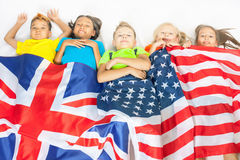 Funny kids holding flag Great Britain and american national flag Royalty Free Stock Photo