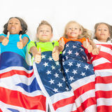 Funny kids holding flag Great Britain and american national flag. Funny kids holding flag of Great Britain and american national flag. Group of school children Stock Photo