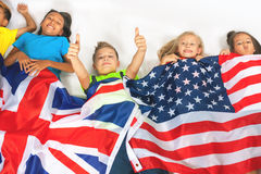Funny kids holding flag Great Britain and american national flag Stock Photos