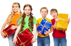 Funny kids holding presents Royalty Free Stock Images