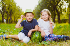 Funny kids holding watermelon. Child Healthy Eating Stock Images