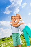 Funny kids hugging together on a meadow Royalty Free Stock Photo
