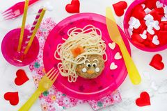 Funny kids lunch spaghetti pasta with meatball Stock Photos