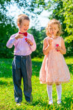 Funny kids  makes soap bubbles Stock Photo