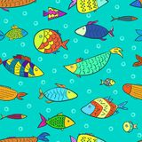 Funny kids pattern with colorful cartoon fishes. Funny kids seamless pattern with colorful cartoon sketch fishes and air bubbles in turquoise water. Vector cute Royalty Free Stock Image