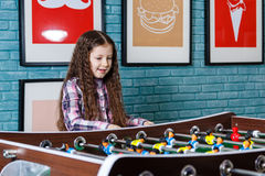 Funny kids playing table football in a cafe on Valentine's Day Royalty Free Stock Photos