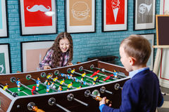 Funny kids playing table football in a cafe on Valentine's Day Stock Images