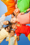 Funny kids in round on sky background Stock Photos