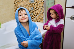 Funny kids after soul in the bright robes Royalty Free Stock Image