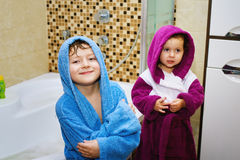 Funny kids after soul in the bright robes Stock Photo