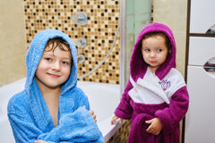 Funny kids after soul in the bright robes Royalty Free Stock Photography
