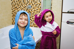 Funny kids after soul in the bright robes Stock Photography