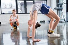 Funny kids in sportswear training at fitness studio together. Children sport concept stock images
