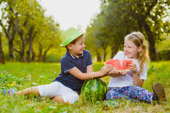 Funny kids taste watermelon. Child Healthy Eating Royalty Free Stock Photography