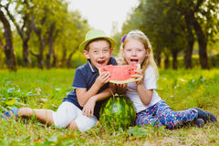 Funny kids taste watermelon. Child Healthy Eating Royalty Free Stock Image