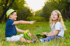 Funny kids taste watermelon. Child Healthy Eating Stock Photography